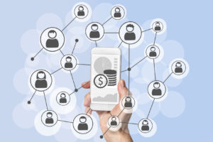 Omnichannel and viral social marketing and mobile sales concept with hand holding modern smart phone